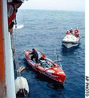 Mick Dawson awaits rescue by Japan Coast Guard searchers in the Pacific Ocean off Miyagi Prefecture.