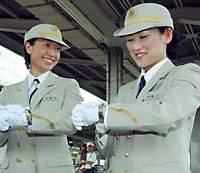 Yasuko Umeda (left) and Azusa Sakaguchi, two of the first four women bullet train drivers on the Tokaido Shinkansen Line, check their watches before setting out Friday from JR Nagoya Station.