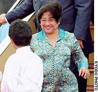 Indonesian President Megawati Sukarnoputri arrives at Tokyo's Haneda airport for a four-day official visit.