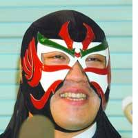 The Great Sasuke talks to reporters in Morioka, Iwate Prefecture, after the prefectural assembly voted down a motion that would have banned the pro wrestler from wearing his mask at the legislature.