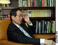 Former Peruvian President Alberto Fujimori gives his first extensive interview since being ousted from his post in November 2000, at a Tokyo rooftop social club.