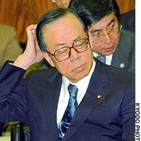 Chief Cabinet Secretary Yasuo Fukuda scratches his head during a House of Councilors committee meeting.