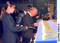 Relatives of the victims of the earthquake that devastated Hokkaido's Okushiri Island in 1993 pray Saturday at a memorial ceremony in Okushiri.