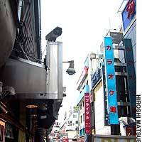 A newly installed 24-hour surveillance camera watches over the Okachimachi jewelry store district in Tokyo's Taito Ward.