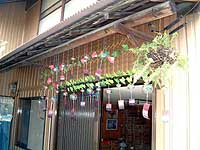 Glass wind bells hang from a house in the Odo district of Asahi, Aichi Prefecture, ahead of a summer festival featuring the ornaments that begins Sunday. | PHOTO COURTESY OF HIDEKI MISHIMA