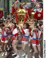 A group of women carry a 'mikoshi' portable shrine during Osaka's Tenjin Festival last year.