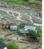 A landslide in Minamata, Kumamoto Prefecture, leaves two people dead and 13 others missing Sunday.