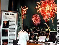 A visitor to the Ryogoku Fireworks Museum in Tokyo's Sumida Ward views an exhibit.