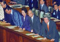 MEMBERS OF PRIME MINISTER Junichiro Koizumi's Cabinet bow Friday after a no-confidence motion against the Cabinet was voted down during a Lower House plenary session. (Kyodo Photo)