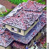Roof tiles litter the garden of a house in Kanan, Miyagi Prefecture, on Saturday morning after a series of strong earthquakes shook the northeastern prefecture.