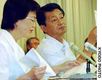Yasushi Chimura and his wife, Fukie, present a letter from their daughter at a news conference in Obama, Fukui Prefecture.