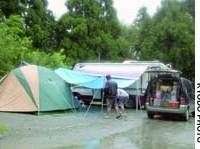Campers at A site in Nishi-Izu, Shizuoka Prefecture, prepare to go home Saturday after a mudslide that had blocked the road was cleared.