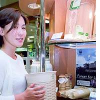 A woman holds a basket made from legally logged trees at the Mitsukoshi chain's flagship department store in Chuo Ward, Tokyo.