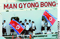 Students chat on board the North Korean ferry Mangyongbong-92 as it prepares to dock at Niigata port.