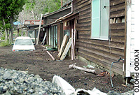 A house on Miyake Island remains unrepaired after its occupants evacuated in 2000 amid volcanic eruptions.