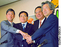 Candidates in the Sept. 20 LDP presidential election join hands at the party's headquarters in Tokyo. They are: former Foreign Minister Masahiko Komura (left), former LDP policy chief Shizuka Kamei, former transport minister Takao Fujii, and Prime Minister Junichiro Koizumi.