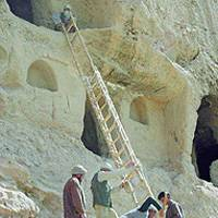 Researchers and local workers prepare to examine ancient caves in Bamiyan, central Afghanistan. Below, a fragment of seventh-century Buddhist scripture that was found by Japanese experts.   PHOTOS FROM THE NATIONAL RESEARCH INSTITUTE FOR CULTURAL PROPERTIES>