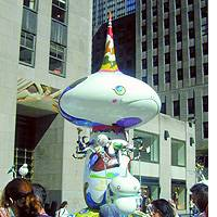 A 9-meter-tall 'Tongari-kun,' Mr. Pointy, goes public at Rockefeller Center in New York.