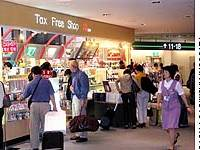Travelers check out the merchandise in a souvenir shop at Narita airport.