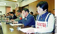 Members of a labor union for the now-defunct Japanese National Railways react to a Supreme Court ruling that Japan Railway group firms are not responsible for the labor practices of their predecessor.