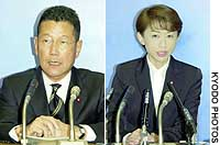 Democratic Party of Japan lawmakers Azuma Konno (left) and Sayuri Kamata field questions after the Sendai District Court convicted their election campaigners of violating the election law.