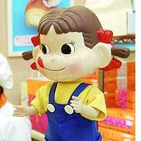 A Peko-chan figure popular among thieves stands on the counter at a Fujiya Co. outlet in Tokyo's Ginza district.