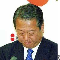 Ichiro Ozawa bows his head during a news conference Monday evening in which he announced he is turning down the presidency of the Democratic Party of Japan.