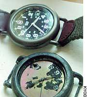 The damaged wristwatch of Shinsuke Hashida, a journalist slain in Iraq, is shown alongside a watch of the same brand that Hashida gave his son earlier this year.