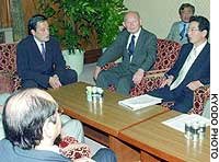 Democratic Party of Japan leaders, including party chief Katsuya Okada (left), meet Monday in the Diet building to discuss legislative strategy.
