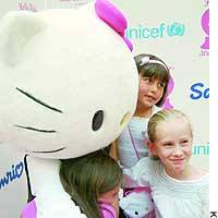 Hello Kitty hugs children during a party in New York to mark the character's 30th anniversary.