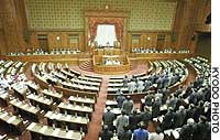 Ruling bloc members pass the pension reform bills in the Upper House on June 5 during a boycott by opposition parties.