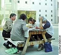 Three siblings take lessons outdoors at Kitano High School in Osaka due to their sensitivity to chemical substances.