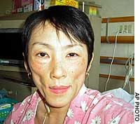 Mika Taira poses on her hospital bed for a snapshot taken by her mother, Nobuko, on March 9.