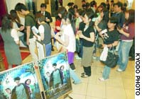 Young Fans stream  for the first showing of 'Harry Potter and the Prisoner of Azkaban' at a theater in Tokyo's Yurakucho district.