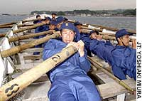 New recruits row a boat off Yokosuka, Kanagawa Prefecture, in early June during basic training for the Maritime Self-Defense Force.