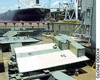 Two workers were killed and two others were injured in an accident Monday at this shipbuilding dock in Kure, Hiroshima Prefecture.