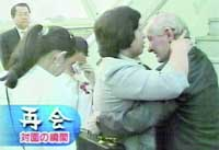 Former abductee Hitomi Soga is reunited Friday with her American husband, Charles Robert Jenkins, and their two daughters at Jakarta airport. | PHOTO COURTESY OF TOKYO BROADCASTING SYSTEM INC.