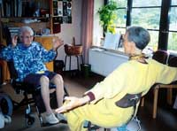 An elderly woman on the Dutch government pension exercises with a staffer at the Rudolf Steiner Verpleeghuis nursing home in The Hague, Netherlands. | ERIKO ARITA PHOTO