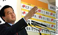 Democratic Party of Japan chief Katsuya Okada holds a news conference to discuss his party's gains.