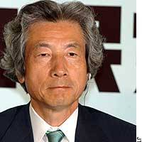 Prime Minister Junichiro Koizumi appears grim as he is interviewed at Liberal Democratic Party headquarters about the party's showing in the House of Councilors election.