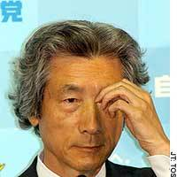 Prime Minister Junichiro Koizumi ponders a question during a news conference at the Tokyo headquarters of the Liberal Democratic Party.