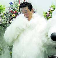 Oga Mayor Issei Sato, clad in a polar bear outfit, fields reporters' questions at the Oga Aquarium Gao in the Akita Prefecture city.