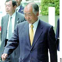 Muneo Suzuki, a former House of Representatives member, enters the Tokyo District Court.