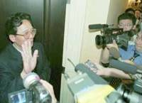 A North Korean official is surrounded by reporters Friday morning at the Jakarta hotel where Charles Jenkins is staying with his family.