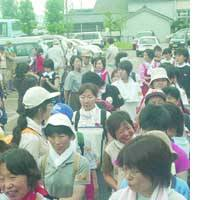 Nakanoshima, Niigata Pref. - Volunteers line up to register Saturday before helping local residents clean up their homes after the area was flooded by torrential rains.