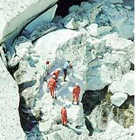 Rescuers search for three hikers who were buried when an ice cave on Mount Arasawa in Niigata Prefecture collapsed on Sunday.