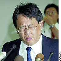 Hideaki Asada, president of Asada Nosan Co., fights back tears at the Kyodo District Court after receiving a suspended sentence.
