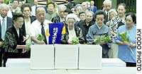 People pay their respects to 16 Japanese soldiers who died in the 1939 Battle of the River Halka and whose remains arrived at the Chidorigafuchi National Cemetery in Tokyo.
