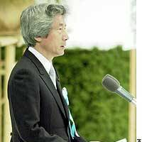 Prime Minister Junichiro Koizumi addresses a ceremony at Nippon Budokan hall in Tokyo marking the 59th anniversary of the end of World War II.