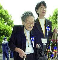 Michiko Okamura, the oldest person taking part in the government-sponsored ceremony Sunday to mark the 59th anniversary of the end of World War II, arrives at Nippon Budokan hall in Chiyoda Ward, Tokyo.